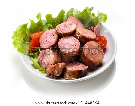 Sausage roasted on the grill. - stock photo