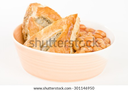 Sausage Roll & Beans - Bowl of sausage roll and baked beans. - stock photo