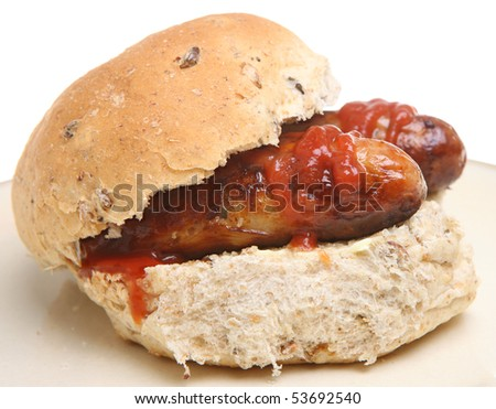 Sausage roll with tomato ketchup. - stock photo