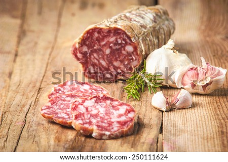 Sausage salami in a rural setting - stock photo