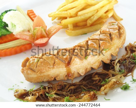 sausage with french fries and salad - stock photo