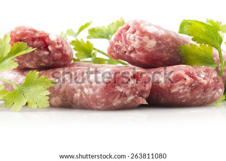sausage with parsley leaves on the white - stock photo