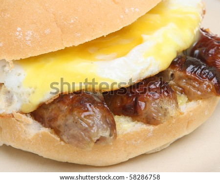 Sausages and fried egg roll. - stock photo