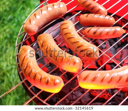 Sausages not grill on a background a grass - stock photo