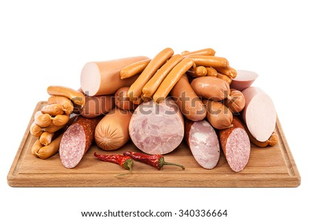 Sausages on a cutting wooden board. - stock photo