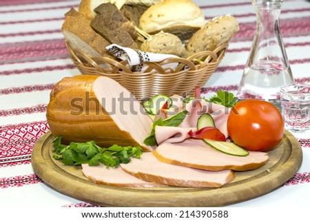 sausages on a wooden plate with vegetables in a restaurant