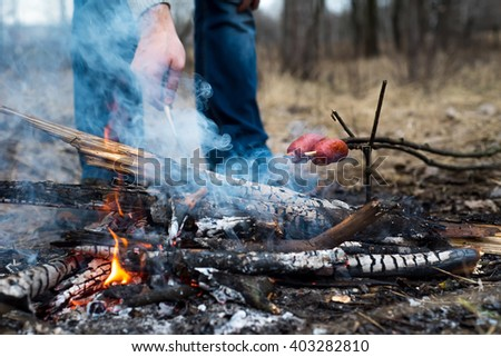 sausages on fire outdoor - stock photo