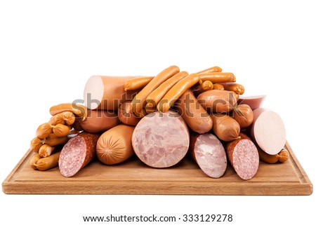 Sausages with a cutting wooden board isolated on white background. - stock photo