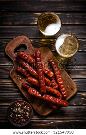 Sausages with beer - stock photo