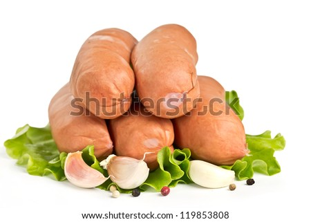 sausages with garlic and parsley on lettuce leaves isolated on white background