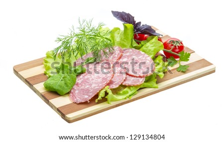 Sausages with salad and basil - stock photo