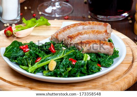 Sausages with vegetable garnish, cime di rapa - stock photo