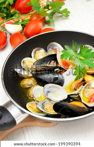 saute seafood in a pan with olive oil and parsley