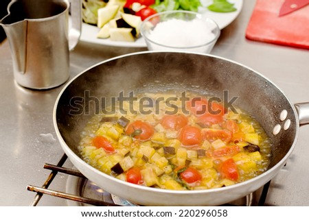 saute vegetables cooking inside pan over food  background