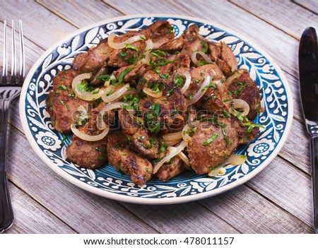 Sauteed chicken liver with apple and onion