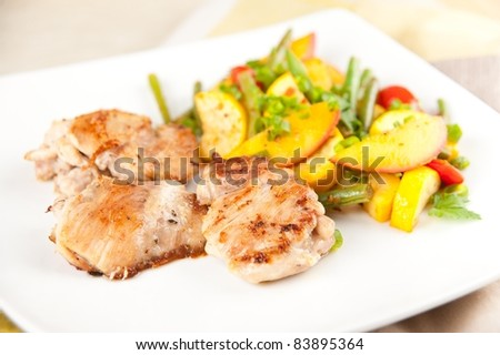 Sauteed Chicken Thighs Served with Vegetables - stock photo