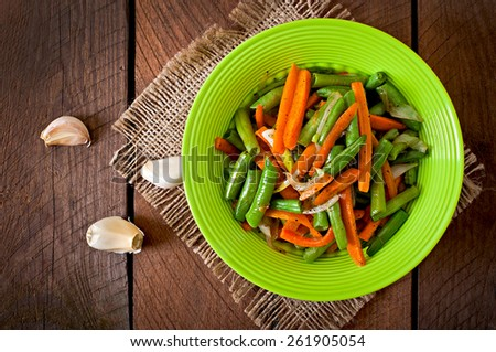 Sauteed green beans with carrots, onion and garlic - stock photo
