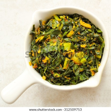 Sauteed greens with garlic and turmeric, overhead view