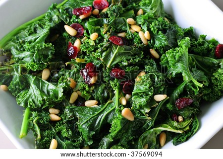 sauteed kale with cranberries and pine nuts - stock photo