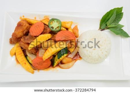 Sauteed mango sauce with rice - stock photo