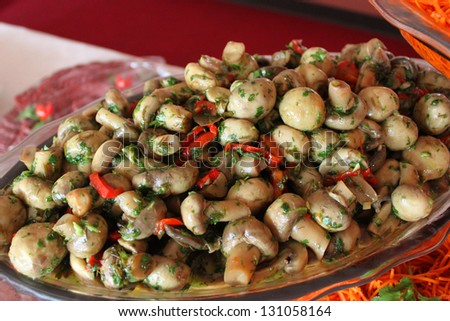 Sauteed mushrooms with peppers and herbs - stock photo