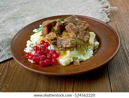 Sauteed reindeer venison steak served with mashed potatoes and lingonberry  -   traditional meal from Lapland, especially in Finland, Sweden, Norway and Russia.