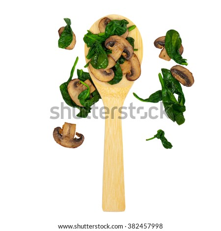 Sauteed Spinach and Mushrooms isolated on white. Selective focus. - stock photo
