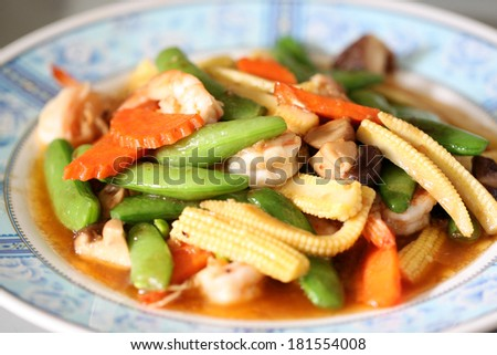 Sauteed vegetables with shrimp in dish. - stock photo