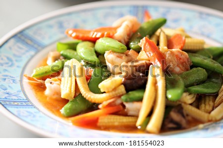 Sauteed vegetables with shrimp in dish.