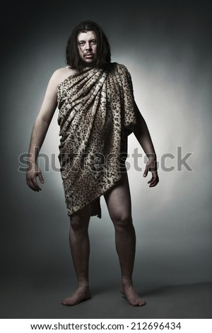 Savage man. Neanderthal. - stock photo