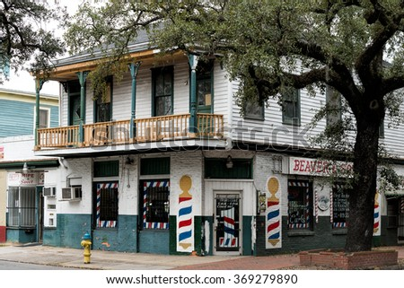 SAVANNAH, GA - JANUARY 6: Older building with fruit and barber shops on ground level and an apartment with porch, photographed in Savannah, Georgia on January 6, 2016 - stock photo