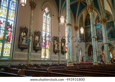 SAVANNAH, GEORGIA - SEPTEMBER 5 : Interior of  St John the Baptist cathedral on September 5, 2016.  The Cathedral was founded in 1700 by the first French colonists.
