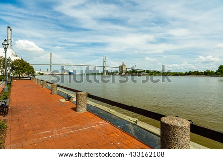 Savannah River in Georgia with the Talmadge Memorial Bridge. - stock photo