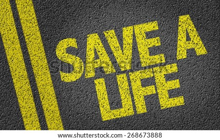 Save a Life written on the road - stock photo