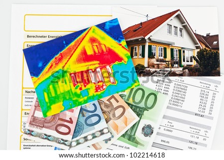 save energy by insulating. house with thermal imaging cameras photographed. - stock photo