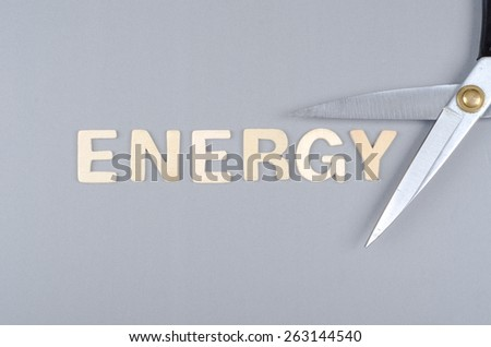 Save energy concept with text and scissor