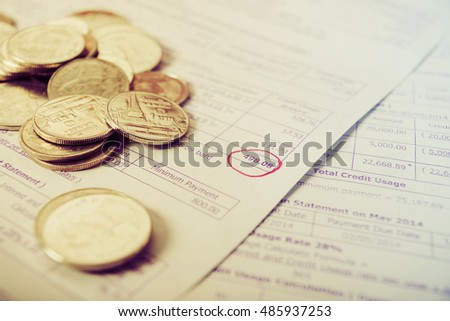 Save money concept, Bill and coins on office table, Bill for income and expenditure, Save money for prepare, Utility bill, Bill for income and expenditure, bill with coins