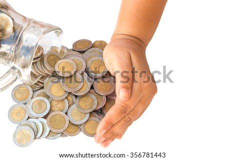 save money concept by hand put coin to money on white background