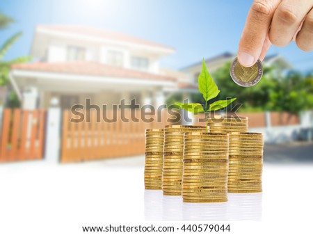 save money for investment concept,Stack of coins isolated,House background,save a money for buy house - stock photo