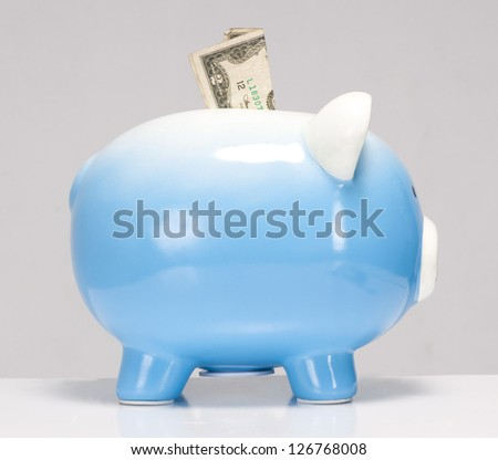 Save Money Two Dollar Bill Stuck in Savings Piggy Bank on white