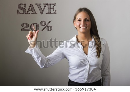 SAVE 20 percent - Beautiful girl touching text on transparent surface - horizontal image