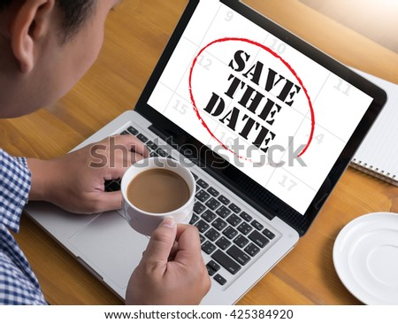 SAVE THE DATE  Businessman at work. Close-up top view of man working on laptop while sitting at the wooden desk , coffee - stock photo