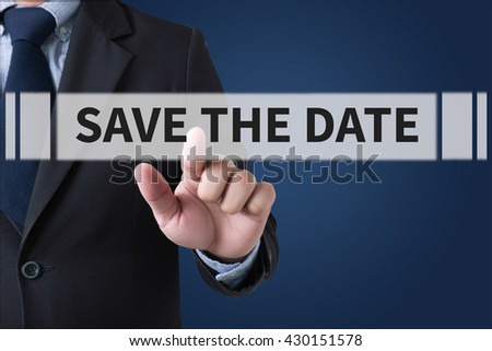 SAVE THE DATE  Businessman hands touching on virtual screen and blurred city background - stock photo