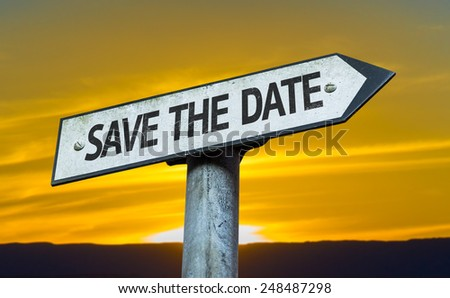 Save the Date sign with a sunset background