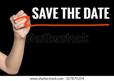 Save The Date word write on black background by woman hand holding highlighter pen - stock photo