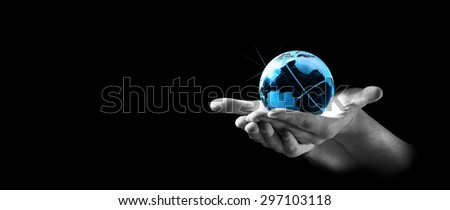 Save the earth concept. Blue globe of glass on black and white man hands, on black background.