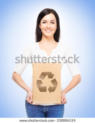 Save the planet concept. Girl holding paper box with recycle symbol on it.   - stock photo