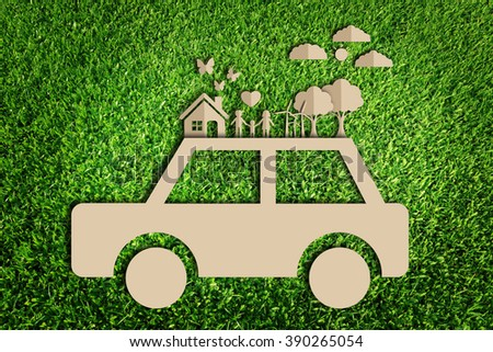Save the world concept. Paper cut of eco on green grass. - stock photo