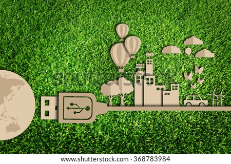 Save the world. Paper cut of Green city concept on green grass. - stock photo