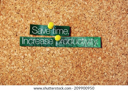 save time ,increase productivity pinned on corkboard - stock photo
